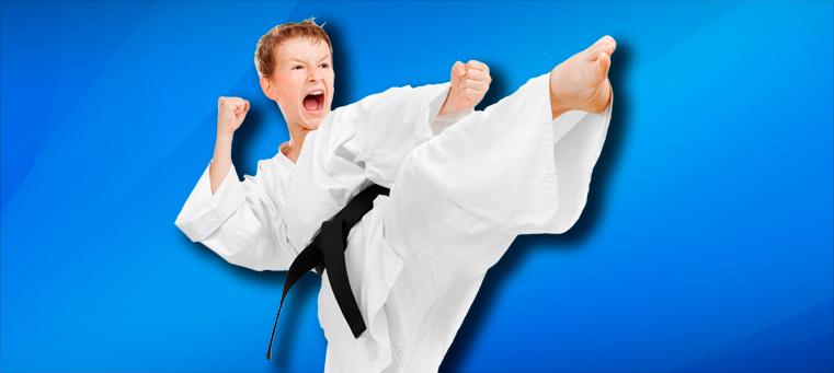 teen boy karate kicking
