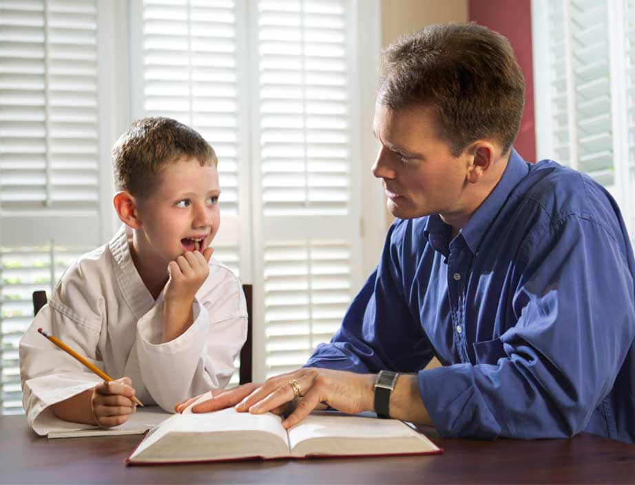 parent helping a child with schoolwork